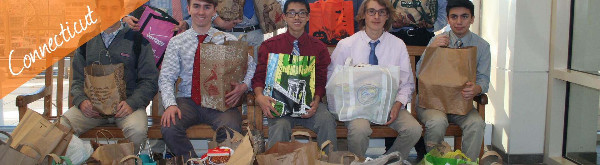Connecticut Car Donation Banner | Teenage Students holding Care Packages for the Needy